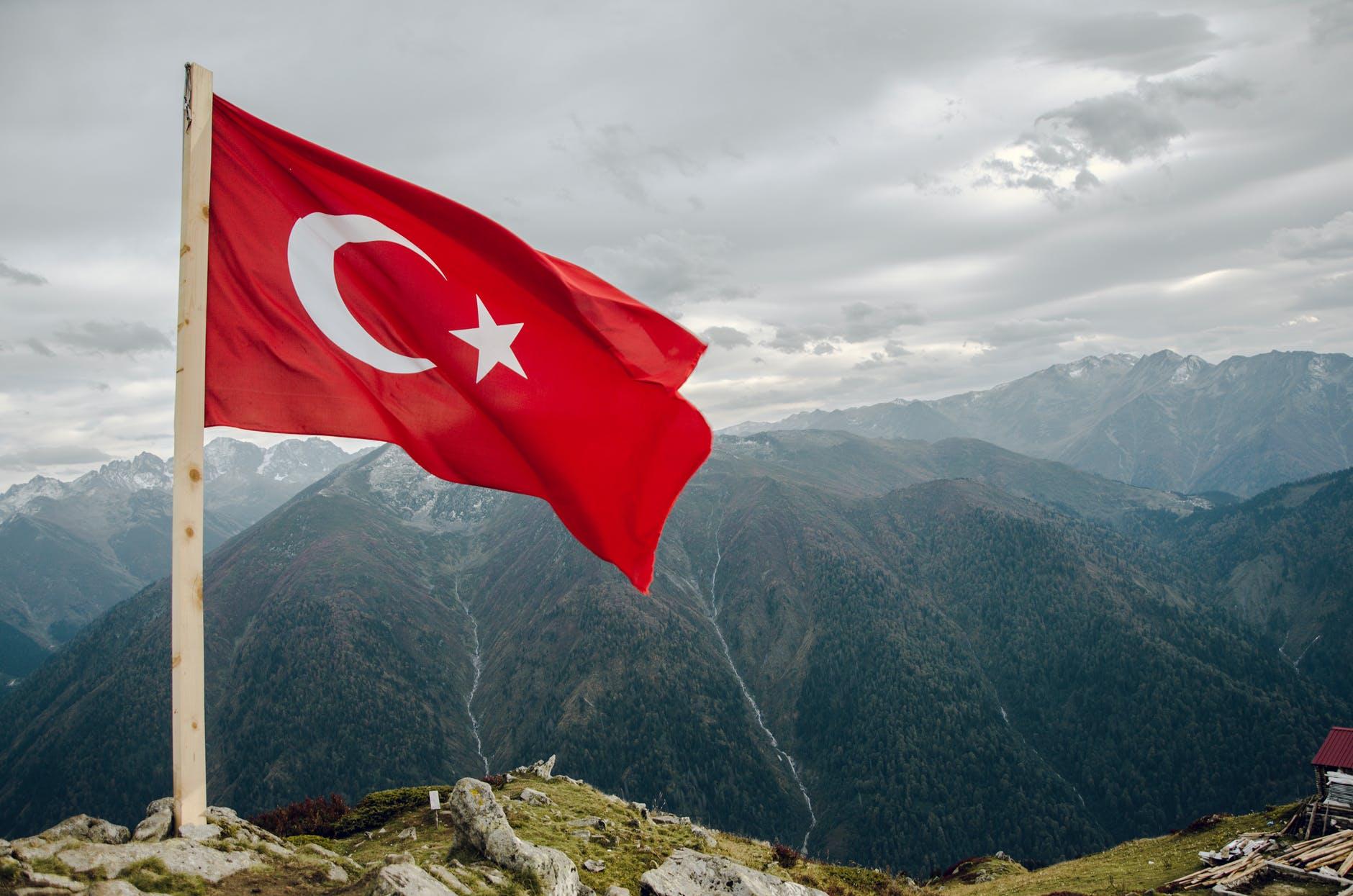 flag of turkey across mountain
