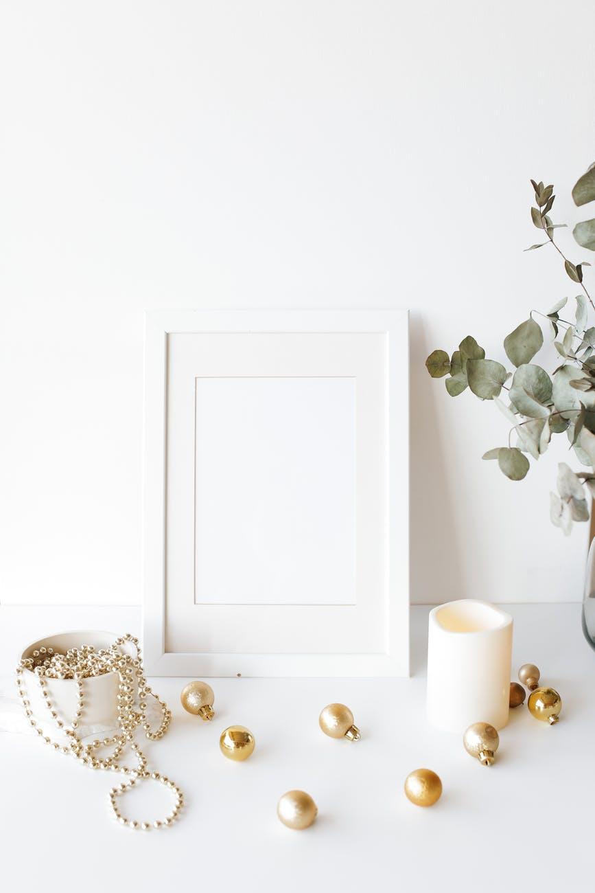 empty photo frame on desk near christmas tree decorations